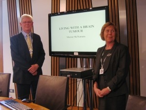 Hamish Guthrie, Carer and Shanne McNamara, Neuro-oncology Clinical Nurse Specialist addressing The Cross Party Group on Cancer at Holyrood
